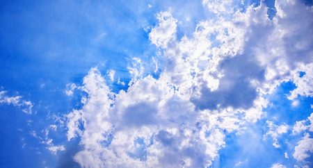 Sun glows in the laptop of cloud.In a Sunny midday Sun peeps bind the cloud - rays glowing inevery direction.concept of Purity ,freedom,etc.
