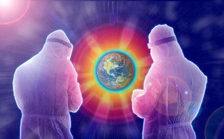 Futuristic concept of two testers dressed in PPE analyzing Earth data to change it from red orange yellow to green blue in the starry universe with cyan glow and beams coming out of the Earth - concepts of laboratory testing for infectious disease like Corona COVID19 SARS CARS through Nasal swab collections. India. Asia. 2020.