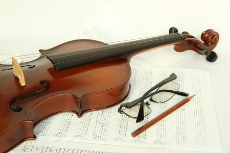 Violin on note with glasses and pencil Stock Photo - 9262975