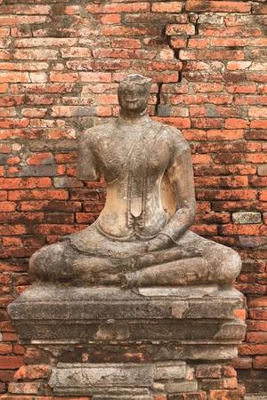 Ruined buddha at Wat Chaiwatthanaram in Ayuthaya province, Thailand. photo