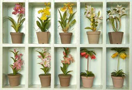Colorful artificial clay flower in flower cabinet