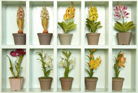 Colorful artificial clay flower in flower cabinet  photo