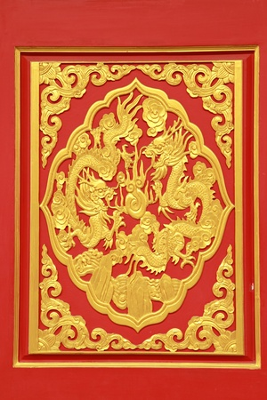 Stock Photo: Golden Chinese Dragon on Red Background at chinese temple in Thailand  photo