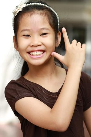 Kleine Asiatin mit l�chelndem Gesicht