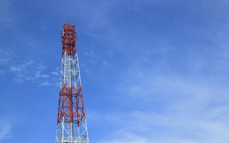 Telecommunication tower with blue sky background. photo