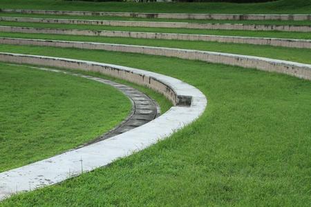 Green grass between concrete stairway photo