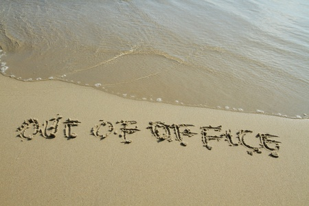 Handwritten in sand on a beach Stock Photo