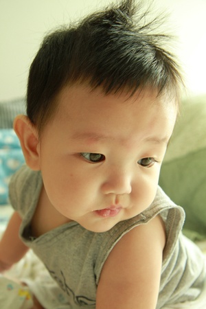 Asian baby boy is looking and thinking Stock Photo