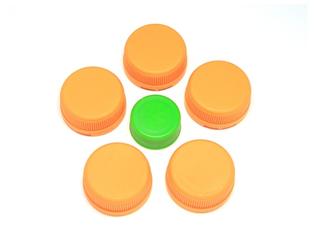 Colorful plastic lids isolated on white background photo