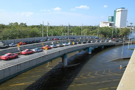 BANGKOK, THAILAND - NOVEMBER 13: Cars park in row on a bridge to avoid flooding during the worst flooding in decades in Bangkok, Thailand on November 13, 2011.