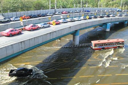 BANGKOK, THAILAND - NOVEMBER 13: Cars park in row on a bridge to avoid flooding during the worst flooding in decades in Bangkok, Thailand on November 13, 2011.