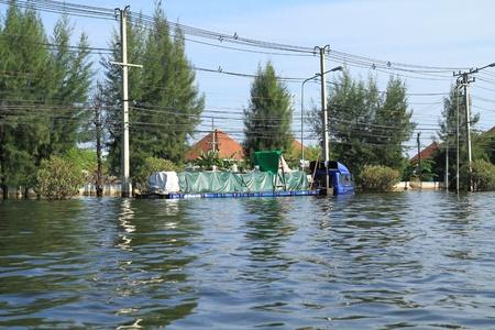 decades: BANGKOK-NOV 13 : Trailer damaged during the worst flooding in decades on November 13,2011 Bangkok, Thailand. Editorial