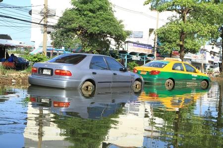 decades: BANGKOK-NOV 13 : Car damaged during the worst flooding in decades on November 13,2011 Bangkok, Thailand.