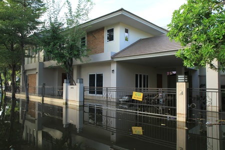 tollway: BANGKOK-NOV 13 : Water from flood in village during the worst flooding in decades on November 13,2011 Bangkok, Thailand.