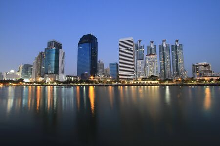 Bangkok city at twilight time with reflection of skyline and building  photo