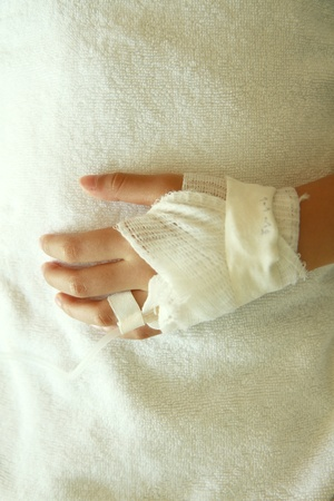 Patients hand  with gauze