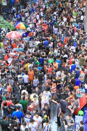 BANGKOK - APRIL 13  Crowd of people celebrating the traditional Songkran New Year Festival, April 13, 2012, Silom road, Bangkok, Thailand   Stock Photo - 13315435