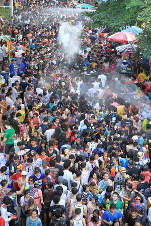 BANGKOK - APRIL 13  Crowd of people celebrating the traditional Songkran New Year Festival, April 13, 2012, Silom road, Bangkok, Thailand   Stock Photo - 13315432