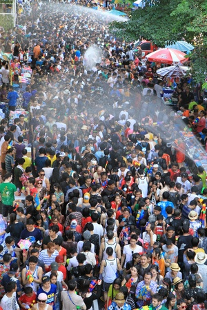 BANGKOK - APRIL 13  Crowd of people celebrating the traditional Songkran New Year Festival, April 13, 2012, Silom road, Bangkok, Thailand   Stock Photo - 13315429