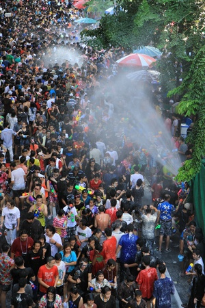 BANGKOK - APRIL 13  Crowd of people celebrating the traditional Songkran New Year Festival, April 13, 2012, Silom road, Bangkok, Thailand   Stock Photo - 13315426