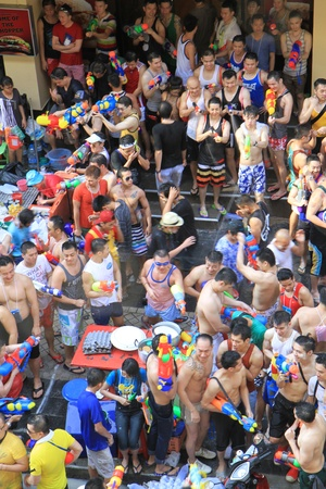 BANGKOK - APRIL 13  Crowd of people celebrating the traditional Songkran New Year Festival, April 13, 2012, Silom road, Bangkok, Thailand   Stock Photo - 13315407