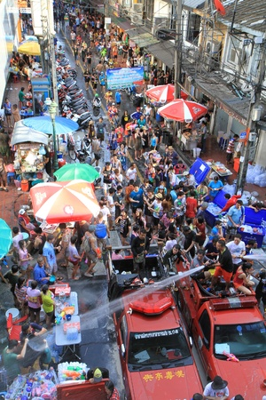 silom: BANGKOK - APRIL 13  Crowd of people celebrating the traditional Songkran New Year Festival, April 13, 2012, Silom road, Bangkok, Thailand