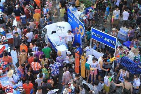 BANGKOK - APRIL 13  Crowd of people celebrating the traditional Songkran New Year Festival, April 13, 2012, Silom road, Bangkok, Thailand   Stock Photo - 13315372