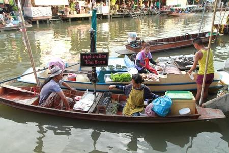 ratchaburi: RATCHABURI, THAILAND - MAY 20  A Thai local in boat at the famous Amphawa  floating market on May 20, 2012 in Ratchaburi, Thailand