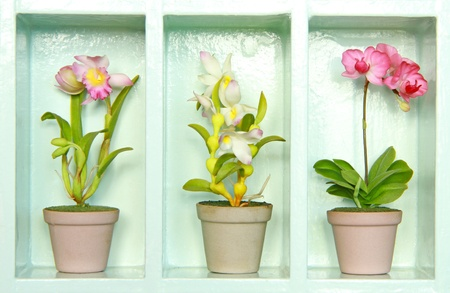Colorful clay flower in flower cabinet  Stock Photo