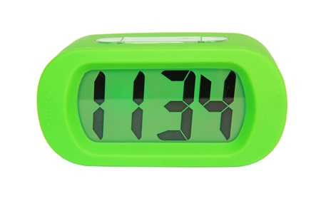 Green digital electronic clock isolated on white background photo