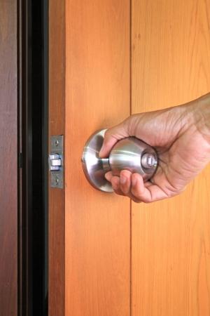 Hand opening the door Stock Photo
