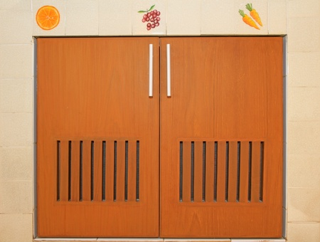 Wooden cabinet doors and handles with tiled frame photo