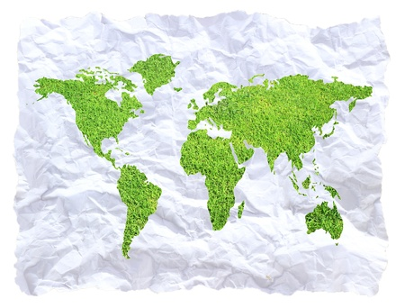 Green global map on crumpled paper photo