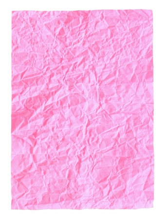 Crumpled pink paper isolated on white  photo