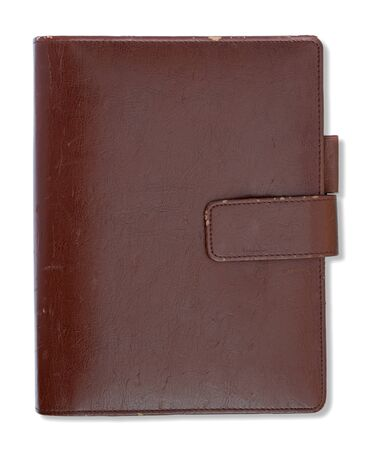 Old brown leather cover notebook isolated on white background photo