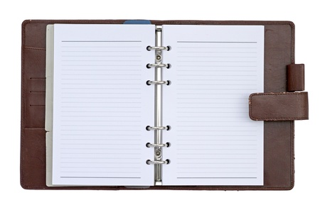Brown leather cover notebook isolated on white background photo