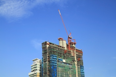Building construction site against blue sky background