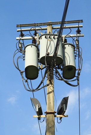 Transformers of an electrical post with powerlines photo