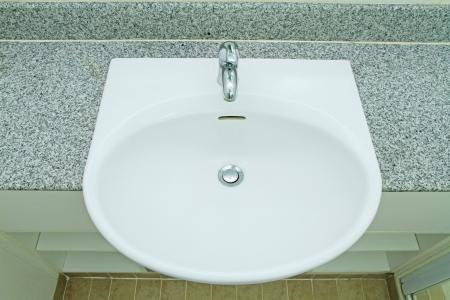 handbasin: Ceramic handbasin on granite countertop
