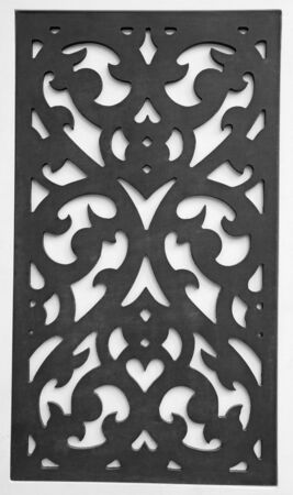 Black perforated wooden on white background photo