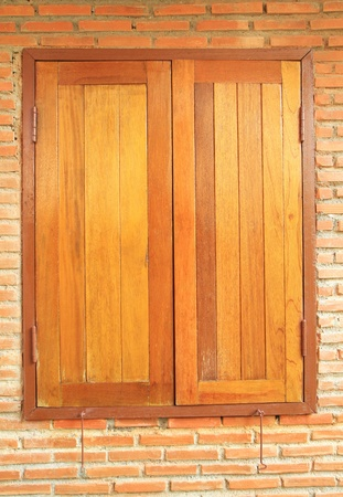 Wooden window on brick wall background Stock Photo - 18690572