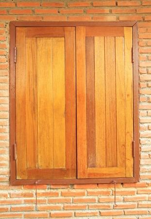 Wooden window on brick wall background Stock Photo - 18690572