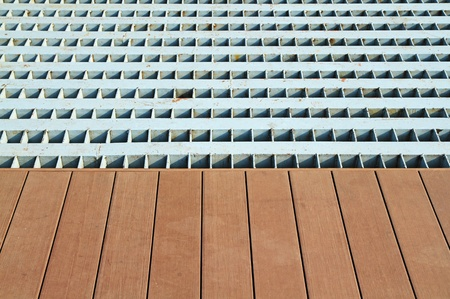 Big metal grate and wooden floor  Stock Photo - 18666646