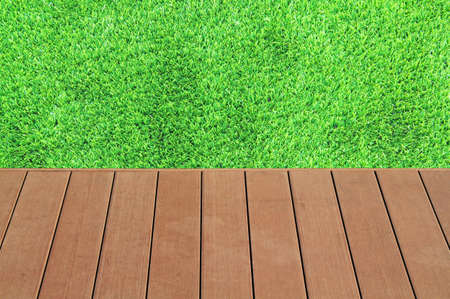 blade of grass: Wooden and green grass background