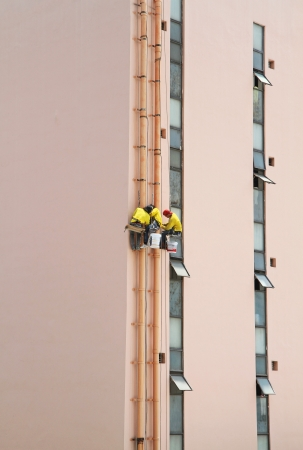 abseil: Workers working on high building