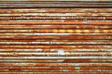 rusted: Stack of rusty metal pipes