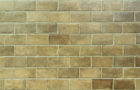 Brown tiled wall background  photo