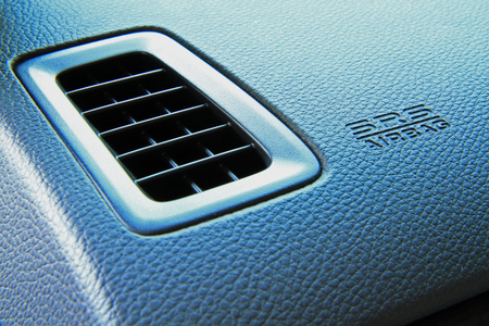 Modern car interior, airbag panel and air ventilation  photo