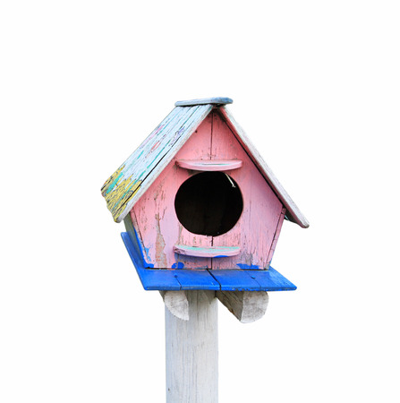 Colorful wooden bird house isolated on white background photo