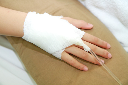 IV solution and patient hand photo